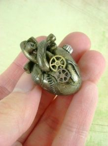Antique brass heart with cogs