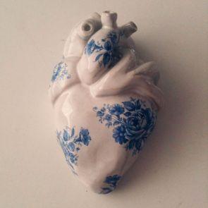 Antique ceramic heart with blue transfers and glaze